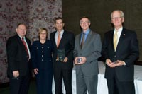 OnCue Express executives receiving Clean Cities Vision Award